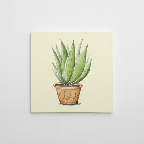 Canvas print with green potted plant on light yellow background.