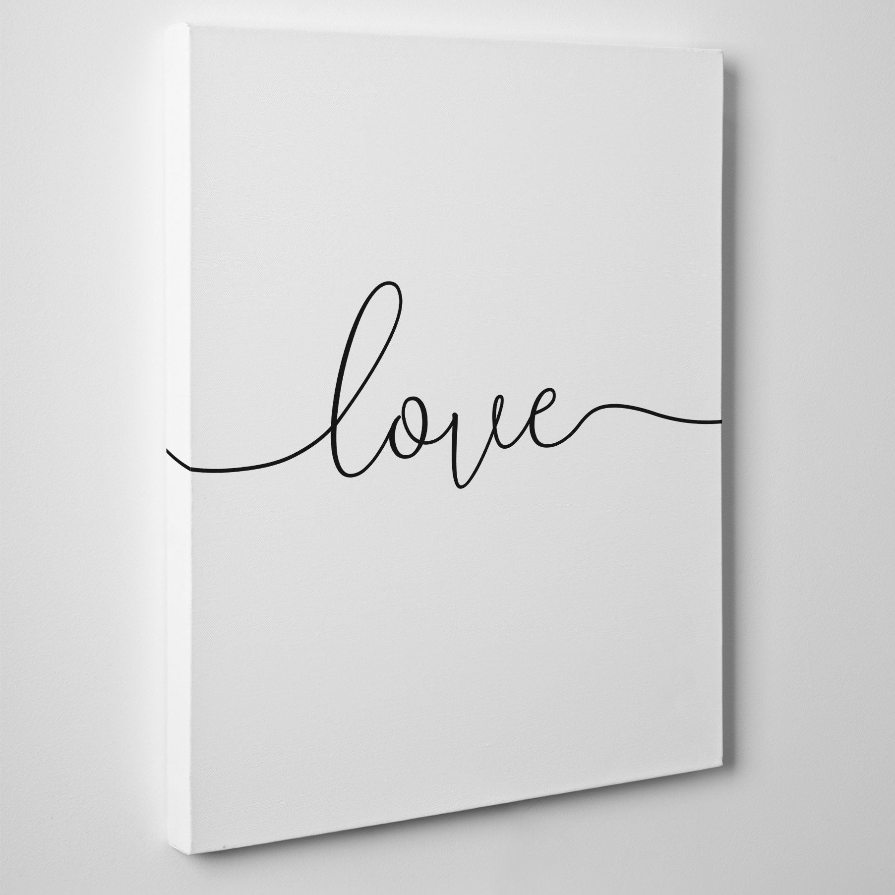 Beautiful canvas print with the single word - love - side view