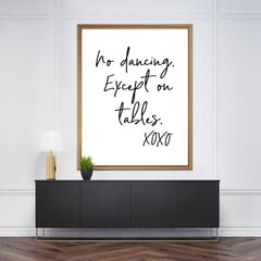 "Poster print with black text ""No dancing. Except on tables. xoxo"", framed"