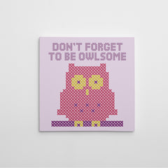 "Stitch style canvas print with an owl and text ""Don't forget to be owlsome"", on a light purple background."