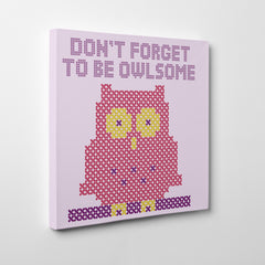 "Stitch style canvas print with an owl and text ""Don't forget to be owlsome"", on a light purple background - side view"