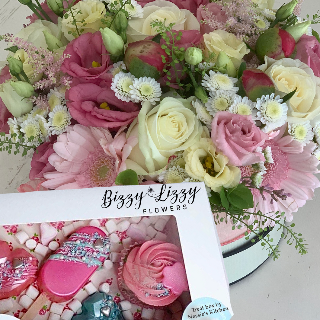 A stunning Florals Hat box in seasonal blooms. A mix of Pinks, creams and foliage with ribbon finish in combination with a Treat box. (Gluten free iption available).
