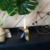 banana candle holder in black and gold