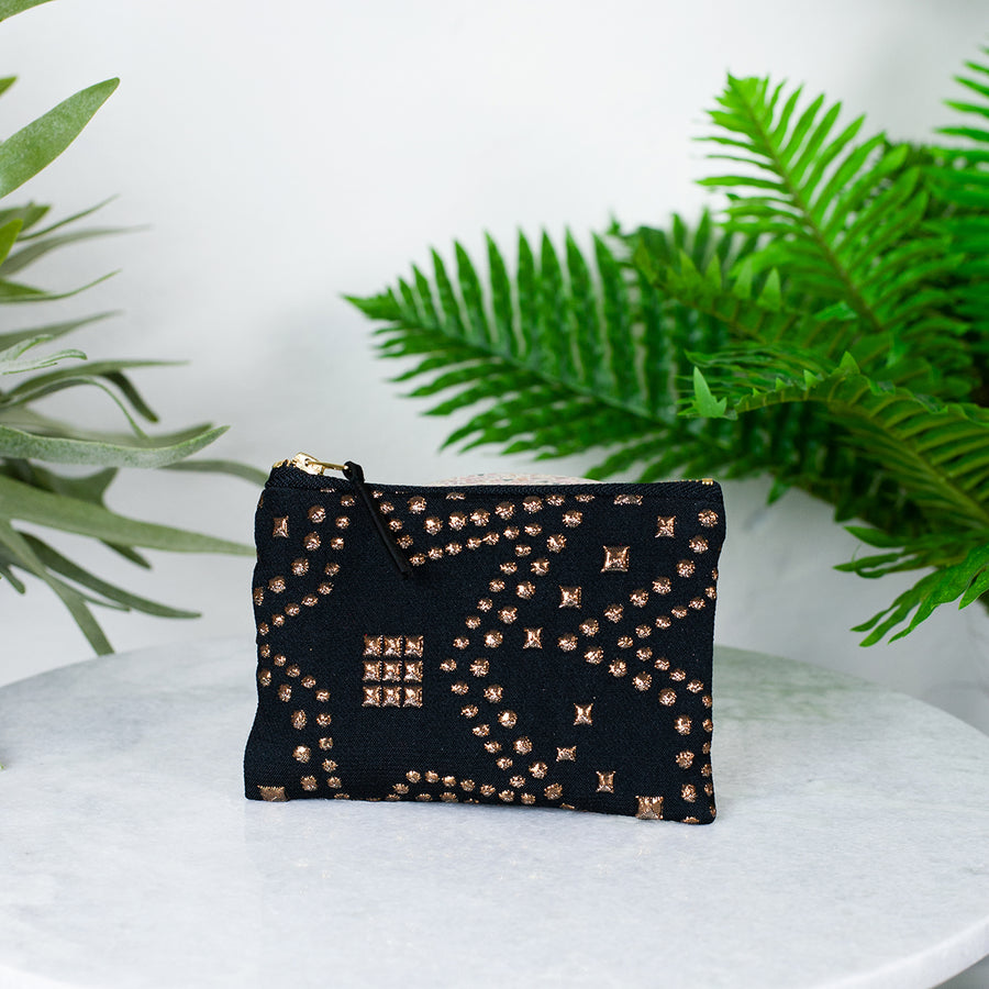 black star studded purse
