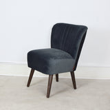 grey velvet chair side view