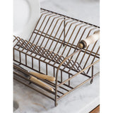 brass dish rack close up