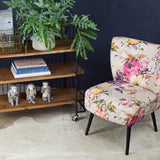 cocktail chair with floral upholstery and black legs