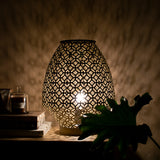 gold table lamp lit up