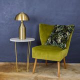 brass table lamp with armchair