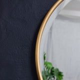 round brass mirror detail