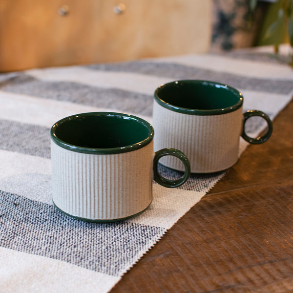 small coffee cup with green trim