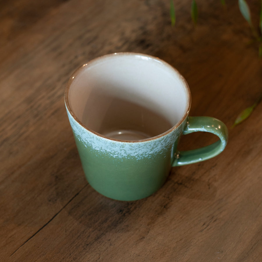 green 70s cappuccino cup with speckled rim