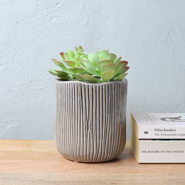 grey ceramic planter ribbed