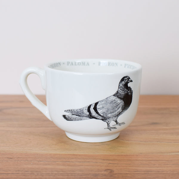 large coffee cup with pigeon illustration