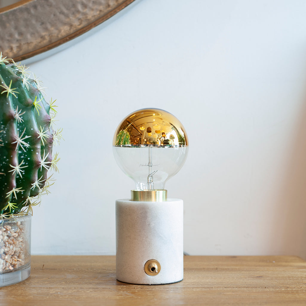 marble and gold exposed bulb table lamp