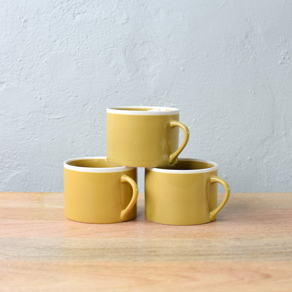 short ceramic mugs in mustard