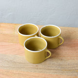 short ceramic mug in mustard detail