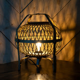 rattan table lamp in the dark