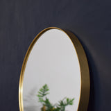 round gold mirror detail