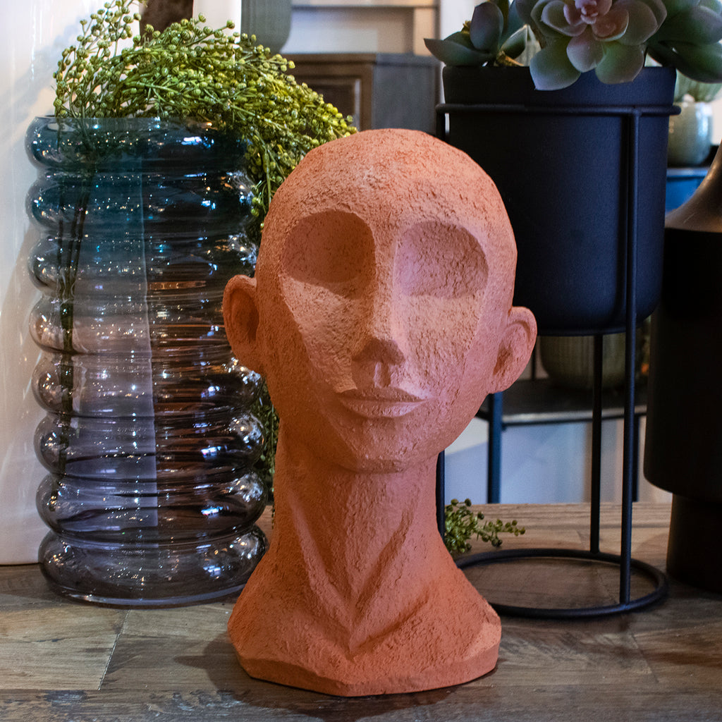 small terracotta head statue