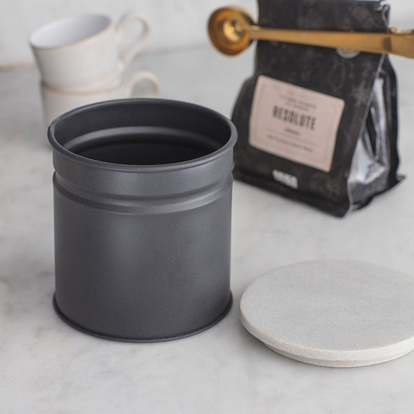 marble and steel canister