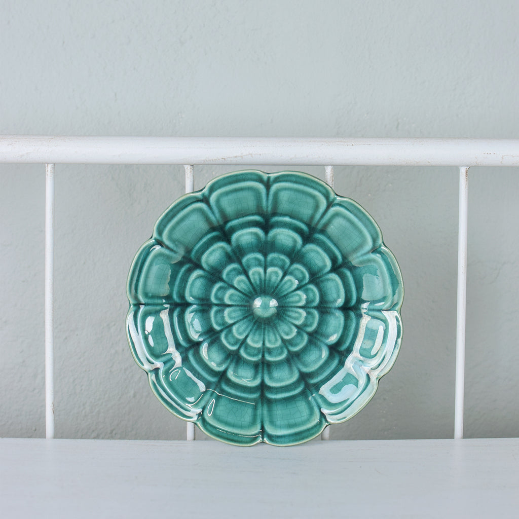 teal ceramic flower wall plaque