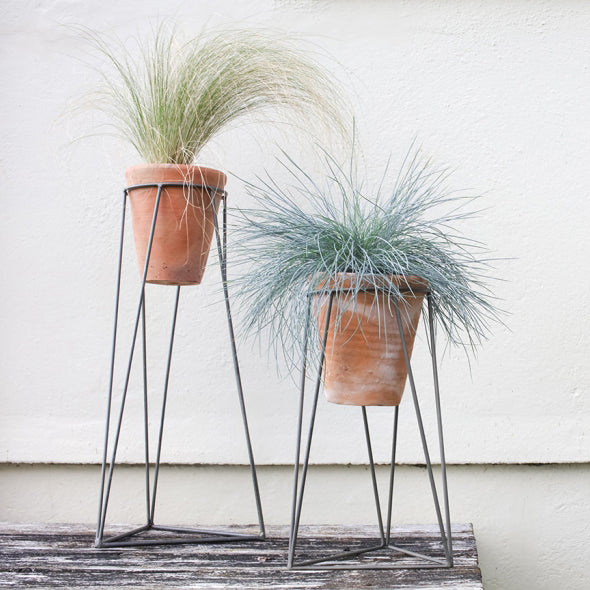 large terracotta planter with metal stand