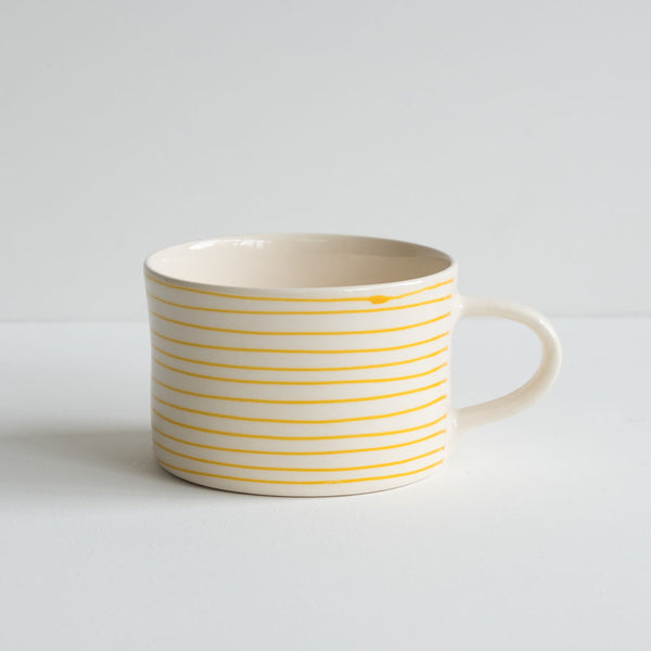 stoneware mug with yellow stripes