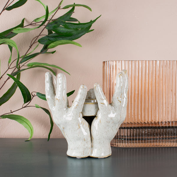 two hands ceramic candle holder
