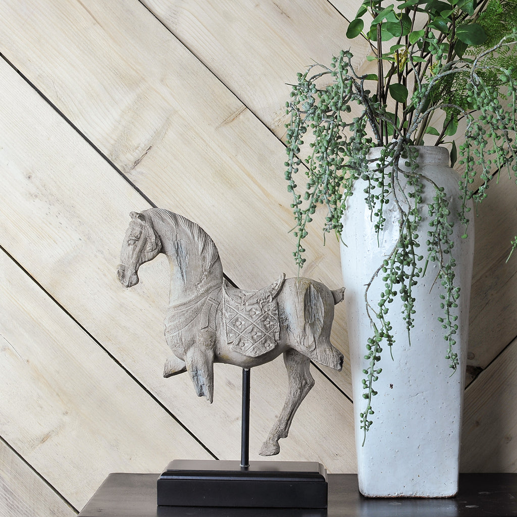 white horse on a stand