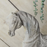 white horse on a stand detail