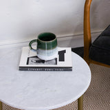 white marble side table details