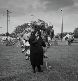 Woman with balloons, Hackney Downs funfair, June 1991