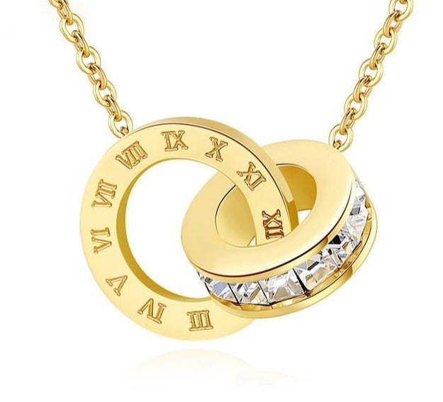 Interlocking Roman numerals necklace, can be added to other necklaces to create layers