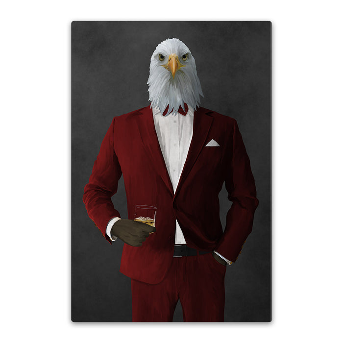 Bald eagle drinking whiskey wearing red suit canvas wall art