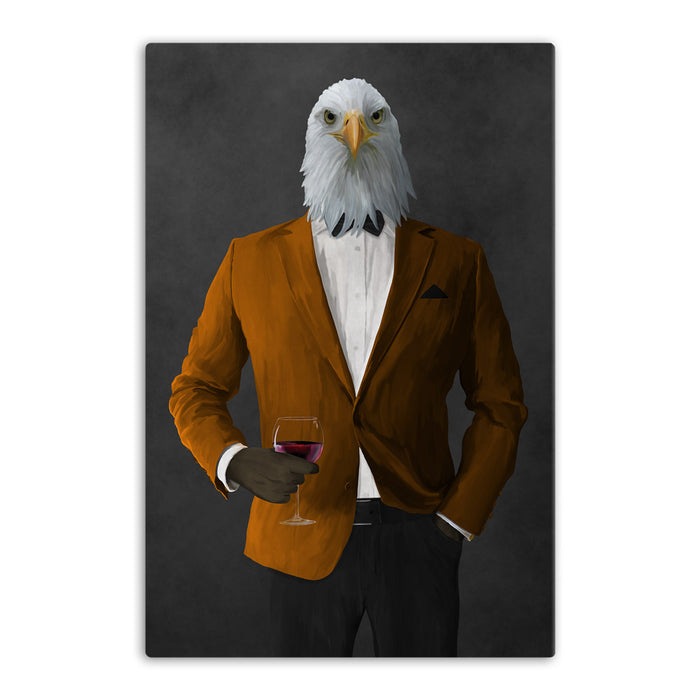 Bald eagle drinking red wine wearing orange and black suit canvas wall art