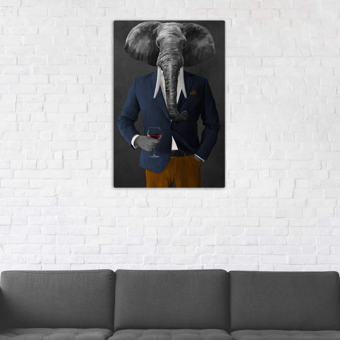 Elephant drinking red wine wearing navy and orange suit wall art in man cave
