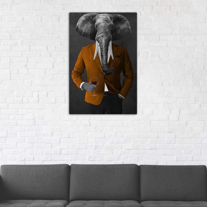 Elephant drinking red wine wearing orange and black suit wall art in man cave