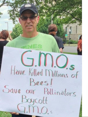 Steve Malone at a March Against Monsanto. Pines strongly opposes GMO farming.