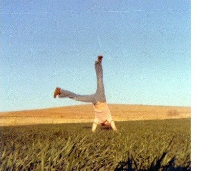 Steve does cartwheels in during our first harvest in April 1977.