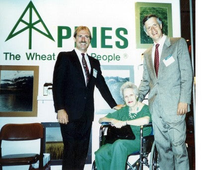 Steve and Ron with Ron's mother at a trade show in 1989.