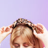 AUDREY SATIN LEOPARD KNOTTED HEADBAND