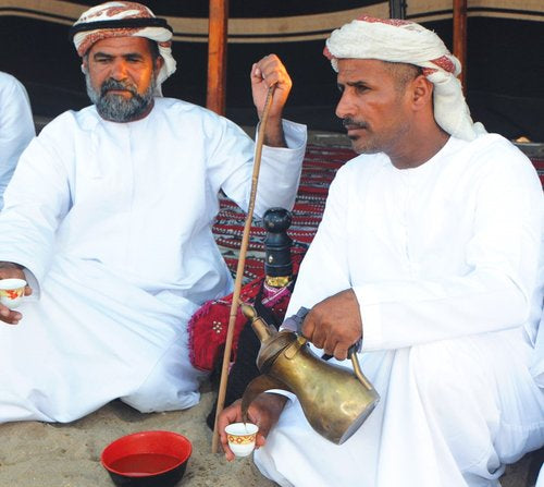 Omanis Drinking Arabic Coffee