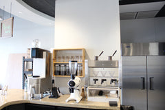 Cafe with coffee equipment and tea on a shelf in Birmingham alabama