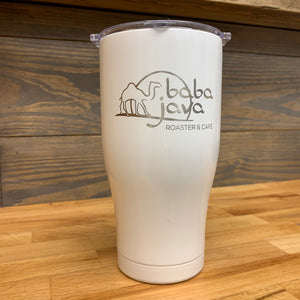 White Baba Java Orca tumbler sitting on a butcher block counter with a wooden background