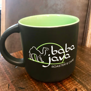 Black Baba Java Coffee Mug sitting on a wooden background