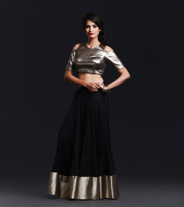 Black Silk crinkled skirt with broad antique gold brocade border paired with shiny black brocade cold shoulder blouse
