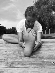 black and white photo woman stretching outside