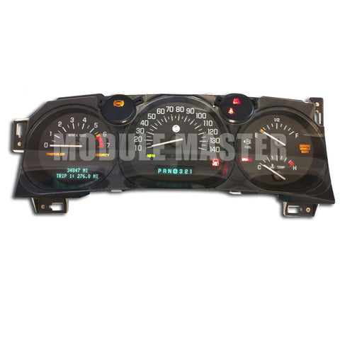 Buick LeSabre instrument cluster powered on with four gauges and LCD screen.
