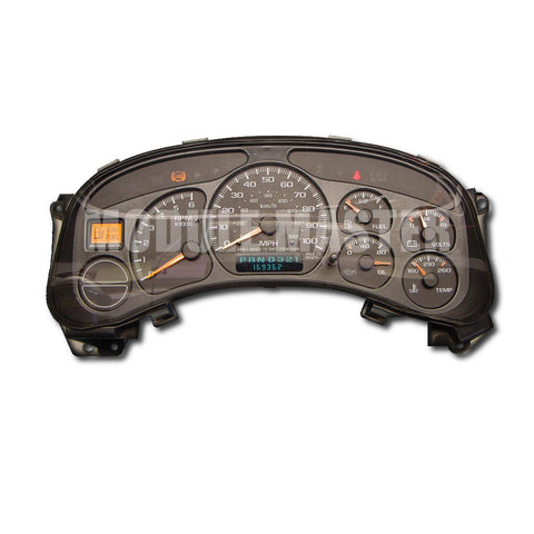 Chevrolet and GMC instrument cluster with six gauges and a small LCD screen beneath the speedometer. Low Fuel, ABS< and Seatbelt light are lit.
